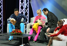 SAVCHENKO / SZOLKOWY and STEUER. PARIS - NOVEMBER 27: Aliona SAVCHENKO / Robin SZOLKOWY and their coach Ingo STEUER (R) review the score during pairs free Royalty Free Stock Photo