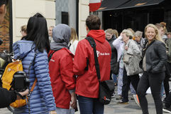 SAVE THE CHILDREN WORKER IN RED JACKET Stock Photography