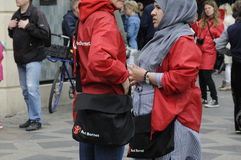 SAVE THE CHILDREN WORKER IN RED JACKET Stock Photos
