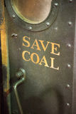 Save Coal on old steam powered locomotive engine Stock Images