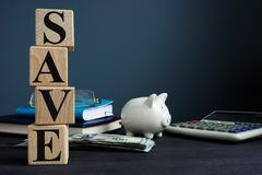 Save from cubes and piggy bank. Money savings concept. Save from cubes and piggy bank. Money savings stock photo