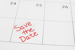 Save the date. Closeup of a calendar with Save The Date text Stock Photography