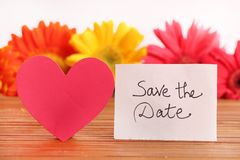 Save the date. Beautiful shot of save the date written on white chit stock photo