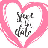 Save the date brush hand painted lettering phrase isolated on the white background with red heart Stock Photos