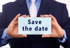Save the date. Business man hold paper save the date text on it royalty free stock photography