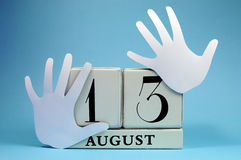Save the Date calendar for International Left Handers Day on August 13. With with block calendar and left hand cut-outs Royalty Free Stock Photography