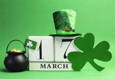 Save the date calendar for St Patricks Day, March 17. Save the date white block calendar for St Patrick's Day, March 17, with Leprechaun hat, pot of gold, and Stock Images