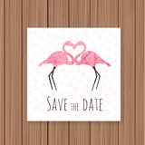 Save the Date card on a wooden background Stock Photography