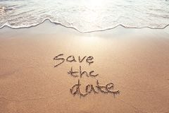Save the date. Card written on the sand Stock Photos