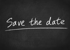 Save the date. Concept text on blackboard background Stock Images