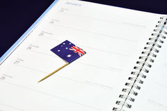 Save the date diary journal for January 26, Australia Day holiday. Australia Day January 26, Australian flag placed in journal diary marking the day Stock Photos