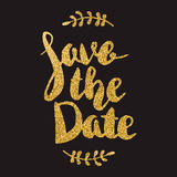 Save the date. Hand drawn lettering with golden flares on dark b Stock Photos