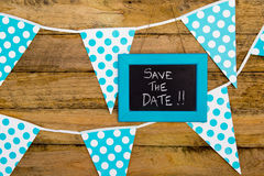 Save the Date - handwritten in chalk on framed backboard against Stock Photography