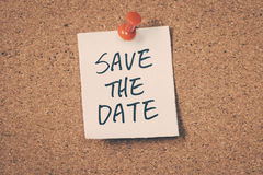 Save the date. Note pin on the bulletin board stock photos