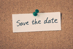Save the date. Note pin on the bulletin board Royalty Free Stock Image