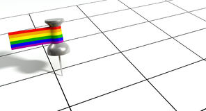 Save The Date Pin With Gay Label. A grey thumbtack with a tape tag attached to it in the colors of the rainbow gay flag on a generic calendar grid background Royalty Free Stock Photo