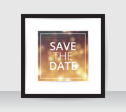Save the date poster template gold blur background on white paper black frame gray wall. Royalty Free Stock Photo