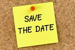 Save the date PostIt Note Pinned To Cork Board. Or corkboard Stock Photos