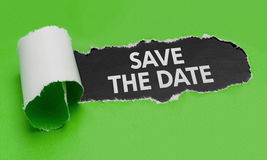 Save the Date. Torn green paper revealing the words Save the Date Royalty Free Stock Photos