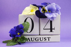 Save the Date white block calendar for August 4, International Friendship Day Stock Photos