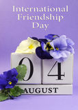 Save the Date white block calendar for August 4, International Friendship Day - vertical Stock Image