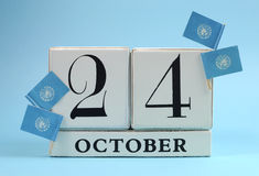 Save the Date white block calendar for October 24, United Nations Day. With the United Nations sky blue flags, against a sky blue background royalty free stock photography