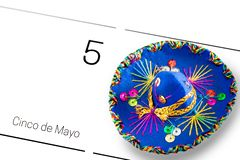Save the date white calendar for Cinco de Mayo, May 5th with blue sombrero decorated with colorful sequins and golden. Cinco de stock images