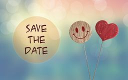 Save the date with heart and smile emoji stock photos