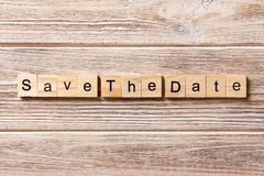 Save the Date word written on wood block. Save the Date text on table, concept stock images