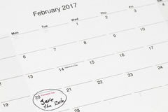 Save the date written on the calendar - February 28,. Circled in black marker stock images