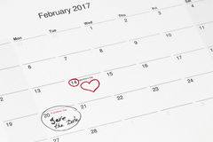 Save the date written on the calendar - 28 February and 14 February. Outlined in black and red marker royalty free stock photography