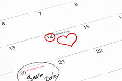 Save the date written on the calendar - 28 February and 14 February. Outlined in black and red marker stock photos