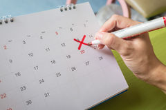 Save the Date written on a calendar - Lucky number 13th.  stock photography