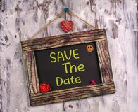 Save the date written on Vintage sign board stock photography