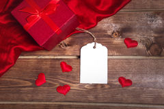 Save Download Preview Wrapped red gift box and gift card on the wooden table can use on valentine day mother day or celebrate Stock Photos
