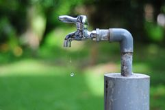 Save a Drop of Water. Nowadays, we have to save our world together. save the water. free abuse, free bad environment Stock Photography