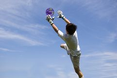 Save the Earth. Soccer Football Goalie making diving save royalty free stock photography