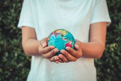Save The Earth and Care Environment Concept, Close-up Portrait of Woman is Holding Mockup Global in Her Hands on Tree Leave royalty free stock image