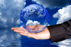 Save the Earth concept - hand holding the planet Royalty Free Stock Image
