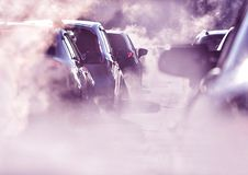 Save the Earth, pollution of environment by combustible gas of a car, traffic jam royalty free stock photography