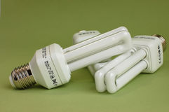 Save Energy. Three energy saving light bulbs on a green background Stock Photography