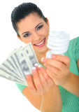 Save Energy Concept. Young woman holding bulb and money stock image