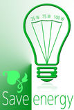 Save energy with green light economic bulb Stock Photography
