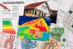 Save energy. house with thermal imaging camera Royalty Free Stock Photo