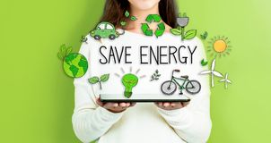 Save Energy With Woman Holding A Tablet Royalty Free Stock Photos