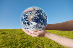 Save Environment Earth. A hand holding a globe, saving environment recycle Royalty Free Stock Photography