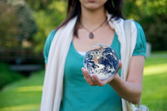 Save Environment Earth. A young woman holding a globe, saving environment Royalty Free Stock Images