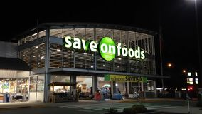 Save on foods at night scene Royalty Free Stock Images