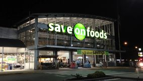 Save on foods at night scene Royalty Free Stock Photos