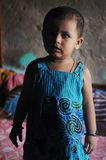 Save Girl Child. June 12,2012 Kolkata,West Bengal,India,Asia-A portrait of a little girl in a home at the slum area of Kolkata Royalty Free Stock Images